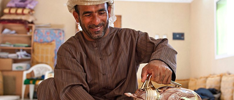 A traditional Omani welcome over strong, hot coffee and dates.